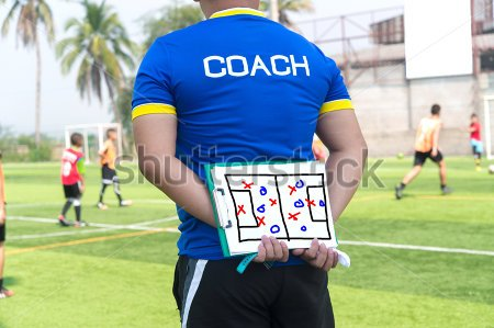 stock-photo-coach-is-coaching-children-training-in-soccer-team-391000690