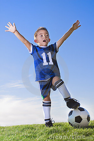 young-boy-soccer-player-celebrating-23537119